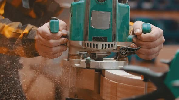 Woodworker Polishes a Top of Wooden Plank