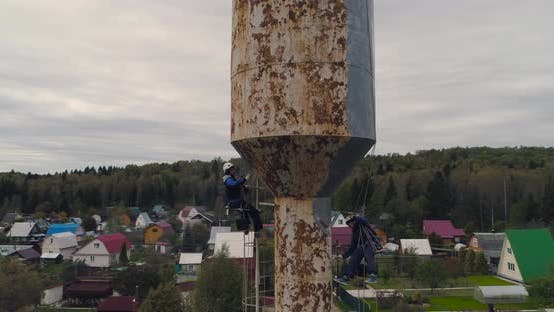 Thumbnail for Industrial Climbers Paint the Iron Tower. Risky Job. Extreme Work. Worker Alpinist.