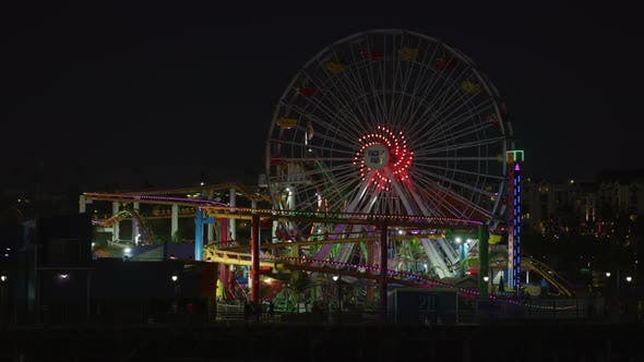 Thumbnail for Ferris Wheel and roller coaster in Pacific Park, at night
