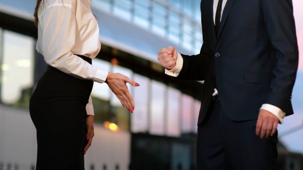 Thumbnail for Rock paper scissors being played by two business partners.