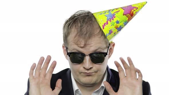 Thumbnail for Drunk Sleepy Businessman in Festive Cap, Sunglasses Showing OK Sign. Hangover