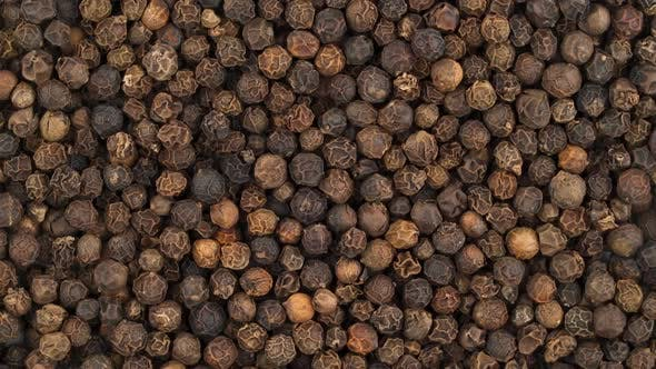 Thumbnail for Top View From Above of a Black Pepper Peppercorn Pile. Rotating