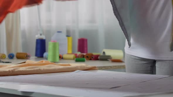 Thumbnail for Interior Designer Female Measuring Curtain Material on Table, Household Products