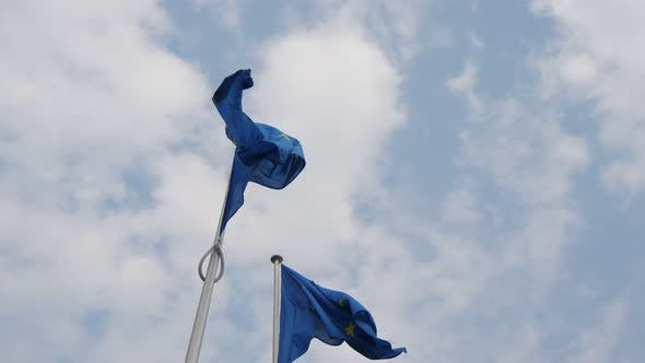 Thumbnail for Two EU Banners Fluttering in the Light Blue and White Air in Belgium in Spring