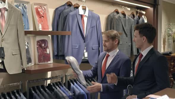 Thumbnail for Friends in Suits Shopping in Menswear Clothing Store