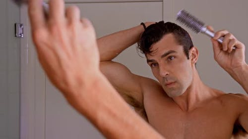 Athletic Man Combing Hair