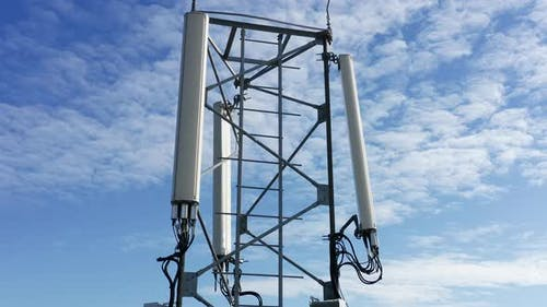 Telecommunications tower carrying broadcasting antennas for 3G, 4G and 5G cellular networks.