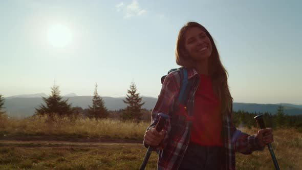 Happy Woman Enjoying Hike in Mountains