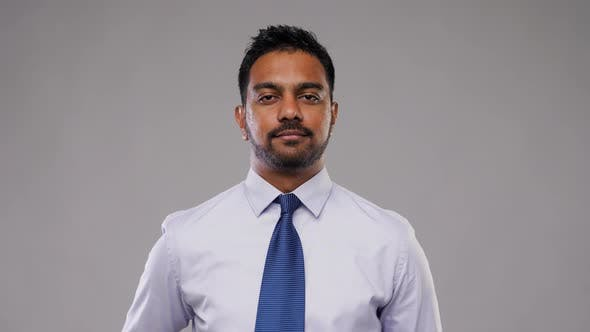 Thumbnail for Indian Businessman in Shirt with Tie Over Grey 1
