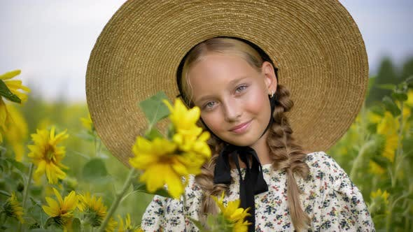Thumbnail for Portrait Beautiful Girl with Two Braids in Hat on Sunflowers Field in Summer Village. Pretty Rustic
