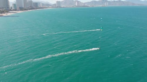 Aerial View of the City Beach and Active People Practicing Kite Surfing and Windsurfing. Kite