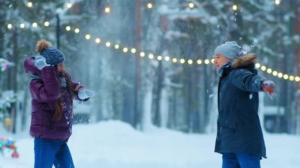 Thumbnail for Couple Plays Snowballs on Skating Rink