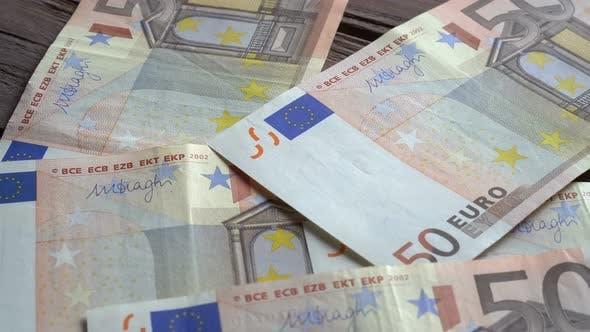Thumbnail for Man Counting Euro Banknotes