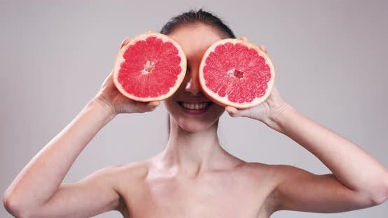 Thumbnail for Girl Hiding Her Eyes with Grapefruit Slices