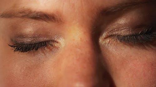 Female Models Closed Eyes with Eyeshadow and Mascara