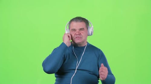 Mn Is Listening To Music on Headphones. Green Screen