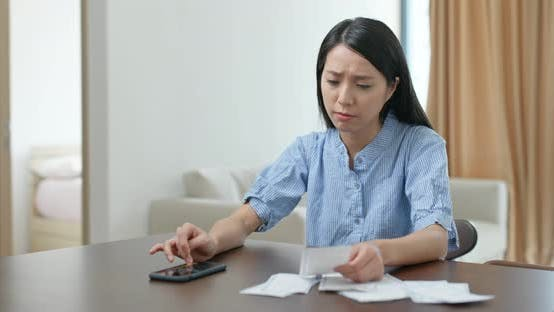 Thumbnail for Woman Use of Mobile Phone Record the Spending of Daily Life