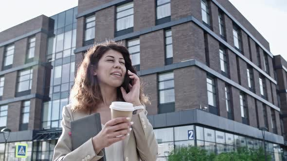 Cover Image for Pretty Business Lady Talking on Phone at Sunny Day