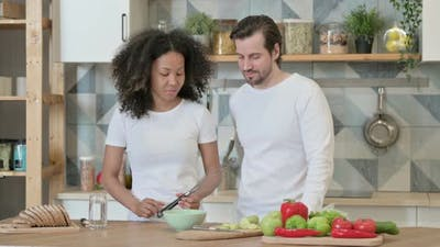 Mixed Race Couple Talking in Kitchen