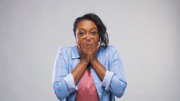 Thumbnail for Scared African American Woman Over Grey Background 18