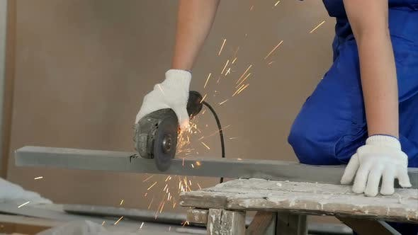 Thumbnail for Industrial Worker Cutting Metal with Many Sharp Sparks at Construction Site