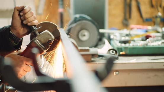 Thumbnail for Steel Industry - Man Using Angle Grinder Grinding Metal Object at Workshop