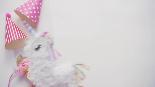 Party hats and unicorn headband on a white background.