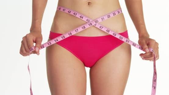 Thumbnail for Closeup of sexy woman measuring waist