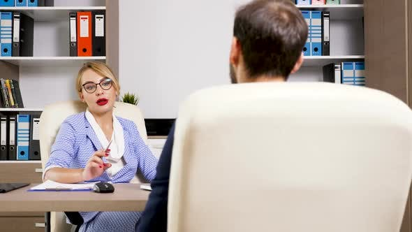Beautiful Blonde HR Woman Interviewing a Candidate for the Job