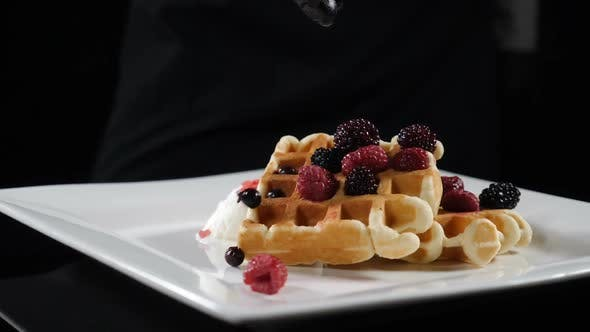 Thumbnail for Delicious Holiday Wafers with Raspberries and Blueberries Served on White Plate. Slow Motion Food