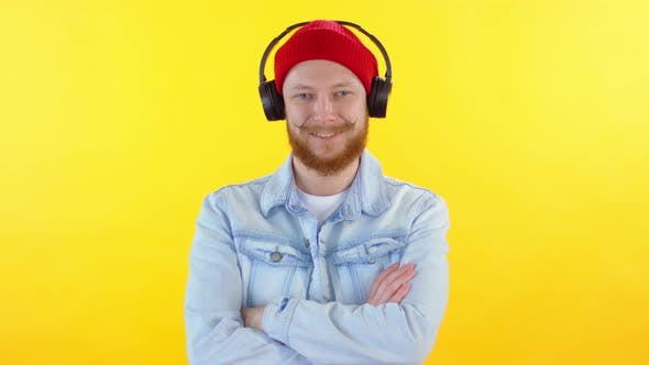 Thumbnail for Man in Headphones Standing with Arms Crossed