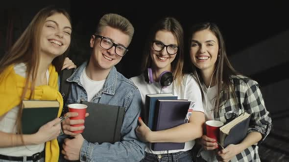 Thumbnail for Group of Friend Standing Together Holding Books