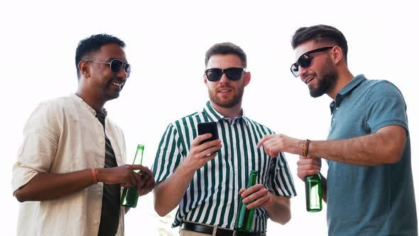Thumbnail for Men with Smartphone Drinking Beer on Rooftop