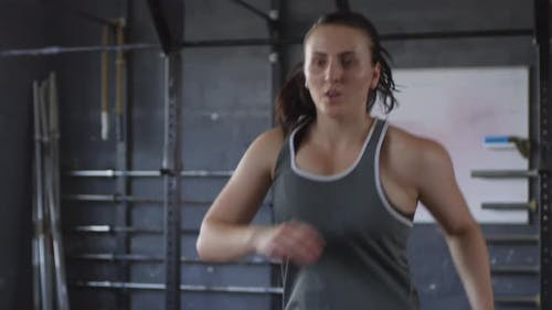 Young Female Fighter Having Intensive Workout in Gym