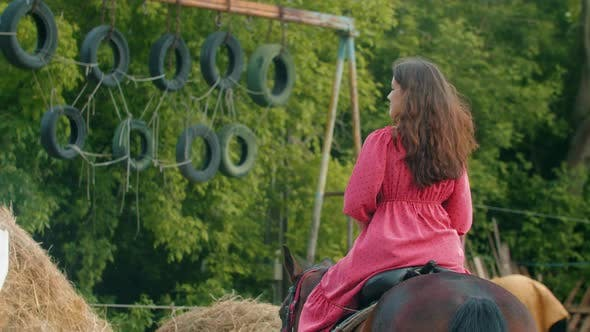 Thumbnail for Young Woman in Pink Dress Riding a Horse