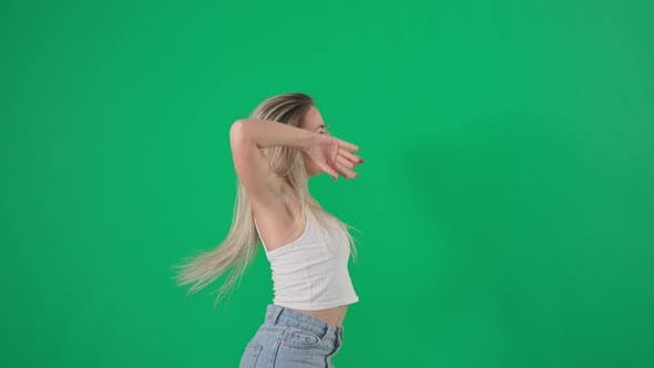 Professional Cheerful Female Dancer with Long Hair is Spinning and Dancing on an Angry Background