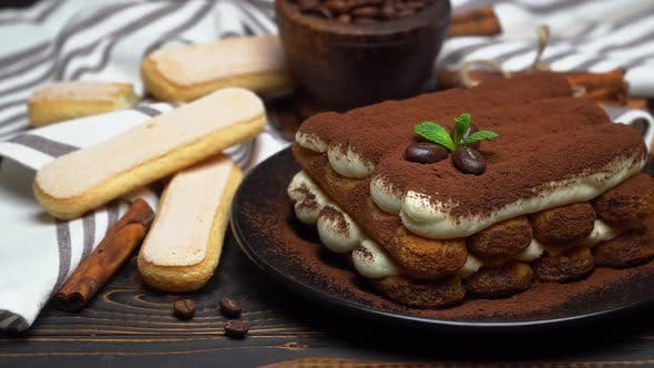 Thumbnail for Classic Tiramisu Dessert on Ceramic Plate and Savoiardi Cookies on Wooden Background