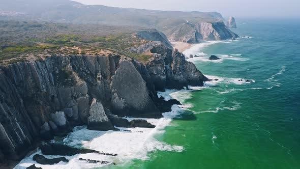 Thumbnail for Aerial View of Atlantic Ocean Waves and Rocky Cost Cliffs Near Praia Grande Beach, Portugal