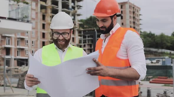 Cover Image for Building a Residential Complex or Business Center. Team of Engineers Men Analyze Plans Construction