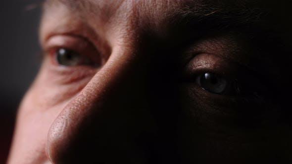 Depressed sad mature man's eyes. Loneliness,depression, sadness