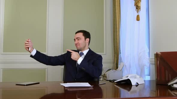 Thumbnail for Happy Businessman Taking Selfie Photo with Cellphone in Office