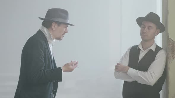 Thumbnail for Two Adult Confident Men in Fedora Hat Standing in the Broken Dirty Place and Talking