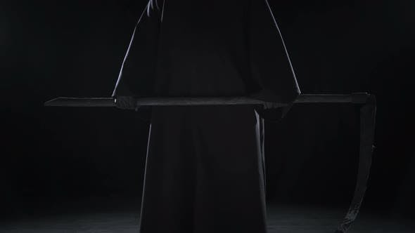 Cover Image for Horrible Dark Figure In A Hoodie With A Scythe Came To Halloween