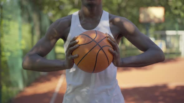 Thumbnail for Unrecognizable African American Sportsman Holding Orange Ball on Outdoor Basketball Court. Young