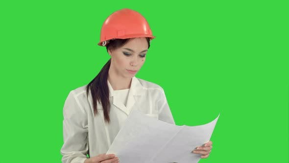 Thumbnail for Young Female Architect Holding Blueprints and Checking Construction on a Green Screen, Chroma Key