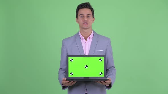 Thumbnail for Happy Young Handsome Businessman Talking While Showing Laptop