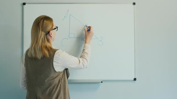 Thumbnail for The Teacher Leads a Geometry Lesson for Younger Children.