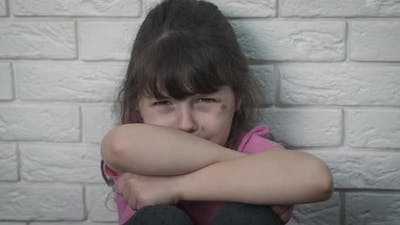 A Depressed Child Cries. Child Abuse.