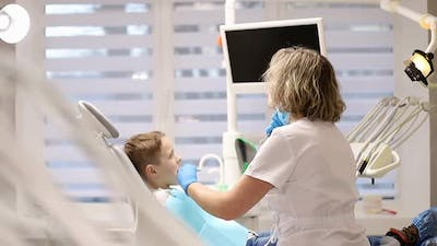 Happy with the work of a child dentist, close-up of a happy little boy in the hospital