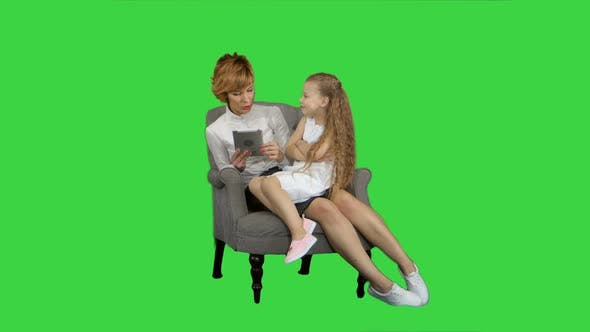 Thumbnail for Caucasian Mum and Daughter Use Tablet on a Green Screen, Chroma Key